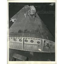 1941 Press Photo Airline worker applies a protective coating to an airplane wing