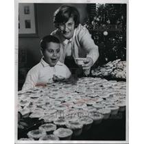 1962 Press Photo Child receiving cupcake from hostess at International Institute