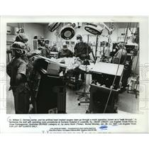 1987 Press Photo Doctor William C. DeVries and staff, Humana Hospital, Kentucky