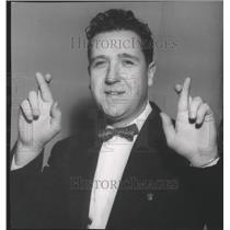 1965 Press Photo Hockey Player Roy McBride Crosses His Fingers for Photo