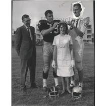 1965 Press Photo Ted Wierman places crown on woman's head with teammate