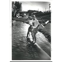 1994 Press Photo Jenny Anderson Helps Dennis McCann Learn to Logrolling Basics