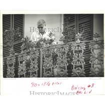 1992 Press Photo Chris Freidrichs Works With Plants on Balcony, New Orleans
