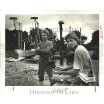 1988 Press Photo Clarence Barrios and Son Shane With Fishing Boats