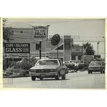 1990 Press Photo View of Street with Signs in Barnstable, Massachusetts