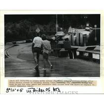 1991 Press Photo Bayou Liberty - Couple Walks on Pontoon Bridge, Louisiana