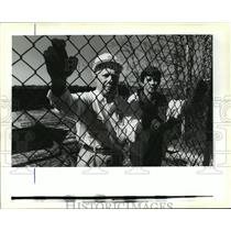 1991 Press Photo David P. Levy and Kevin Davis Stand Along Bayou Lacombe Fence