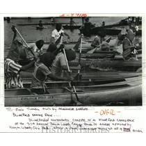 1987 Press Photo Bayou Liberty Pirogue Races - Contestants Compete Blindfolded