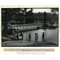 1990 Press Photo Bayou Liberty - Children Fish Near Bayou Liberty Bridge