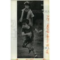 1988 Press Photo Michael Touchy II and sister Kelly Playing Baseball