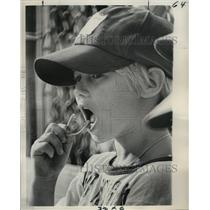 1975 Press Photo Youngster Puts a Mouth Guard in at the Baseball Field