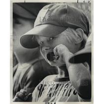 1975 Press Photo Boy Baseball Player Eyeing The Camera Man - noa28449