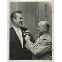 1961 Press Photo Neill Masterson, pins Rex Allen, star of the Rodeo & Stock Show