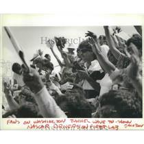 1987 Press Photo Fans on Spokane street wave to race car drivers, Grand Prix