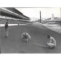 1965 Press Photo Workers check the track surface of Indianapolis Motor Speedway