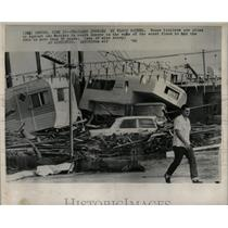 1965 Press Photo Trailer Jumble Flood Water House Pile