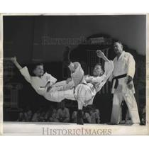 1956 Press Photo Two Judo students fly through the air practicing new tricks