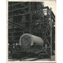 1959 Press Photo Lifting a steam turbine generator at Houston Light and Power Co