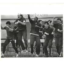 1987 Press Photo Rogers High School Wrestlers Celebrating After Winning