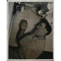 1938 Press Photo Jimmy Lloyd Covers Ear - nes54601