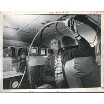 1966 Press Photo Bill Hafenbritle Checks Tube for Air Pollution In Truck-Houston