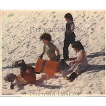 1976 Press Photo Playtime in the snow in Alaska - hca04454