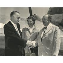 1956 Press Photo Store-Allied-Houston, Officials meet at Airport with Handshake