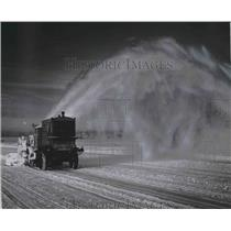 1954 Press Photo Snow blower working on runways at Mitchell Field in Milwaukee