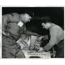 1962 Press Photo Alabama National Guardsmen, make adjustments on aircraft valve.