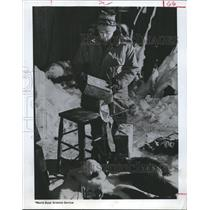 1968 Press Photo Walter H. Dodd Examines A Box of Biscuits & Clothes, Antarctica
