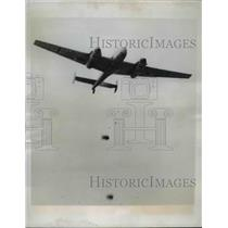1941 Press Photo Two Bombs Leaving the Low Flying Messerschmitt to Explode