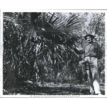 1962 Press Photo Man inspects his trees in Big Thicket, Texas - hca08700