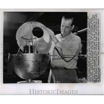 1956 Press Photo US Naval Research workman on final assembly of baby moon