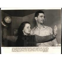 1937 Press Photo Sam Baugh of Redskins Gives Pointers to Fiancee Edmonia Smith