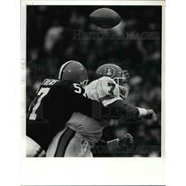 1991 Press Photo Elway Fumbles the ball as he is hit by Clay Matthews
