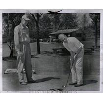 1957 Press Photo Lew Thomas, Fred Holt practice Golf. - RRW00187