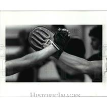 1989 Press Photo Arms of defensive cladded with two variation of the Focus Glove