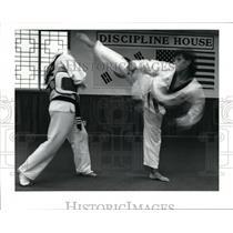1990 Press Photo Joe Kim sweeps a kick over Mike Mignona 's head - cvb35547