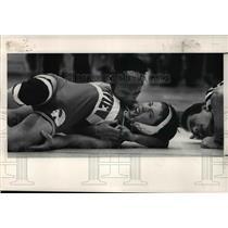 1991 Press Photo Matt Payne is nearly pinned by Bernard Bernardo at championship