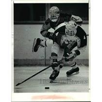 1990 Press Photo St. Ed's, Jeff Badar gets control of the puck - cvb46596