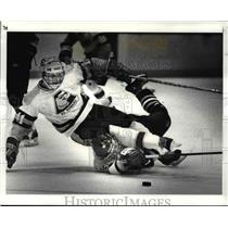 1987 Press Photo St Edwards Winston Breeden lands on top of Jacke Toivanen