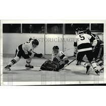 1984 Press Photo Tim Fitz Goes After the Puck at the Feet of Mike Heckman