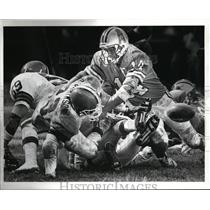 1987 Press Photo: Houston QB Brent Pease fumbles the ball on the Browns 14 yd