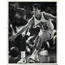 Press Photo Mark Price steals the ball from the 76er's David Wingate