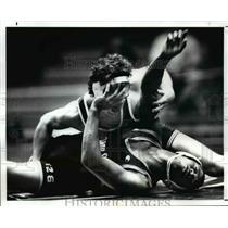 1988 Press Photo Charles Myles Uses his Hand to Fend Off Dan Donovan - cvb53024