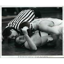 1991 Press Photo Gino Rumplik, Twinsburg, attempts to pin Bailey in wrestling.