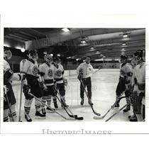 1991 Press Photo Coach McNamara starts practice by setting up a defense rush