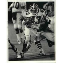 1986 Press Photo Kevin Adams gets 1st down against Midpark football.