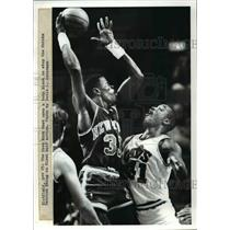 Press Photo: Richfield, The Cavs Mark West uses a body block over Patrick Ewing
