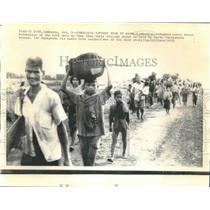1961 Press Photo Refugees flee to Krek as villages are held by North Vietnamese